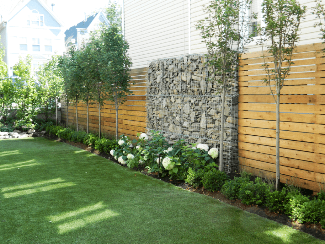 Wood Slat Privacy Fence With Gabion Rock Wall and Landscaping Bucktown Chicago