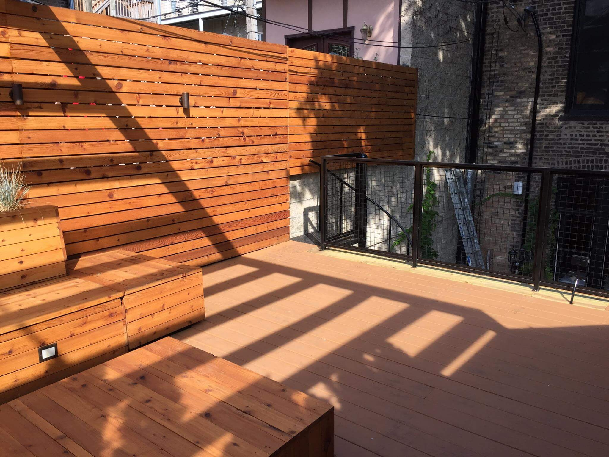 roof deck cedar built in bench seating and planters lakeview chicago