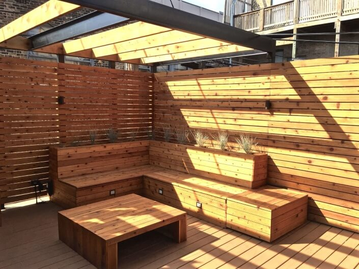 roof deck with built in bench seating and planters lakeview chicago