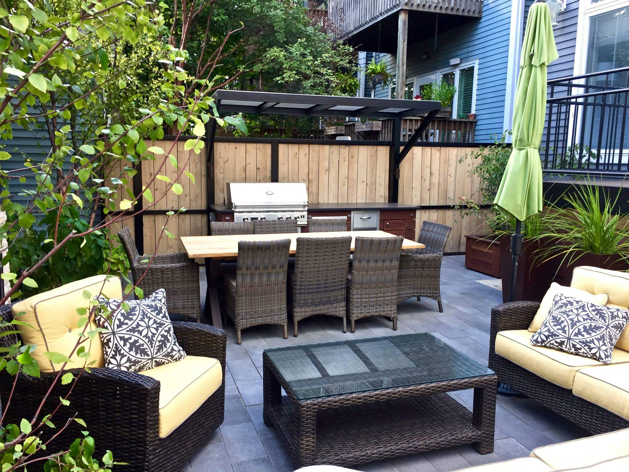 Backyard patio space with furniture and gas grill buffet lincoln park