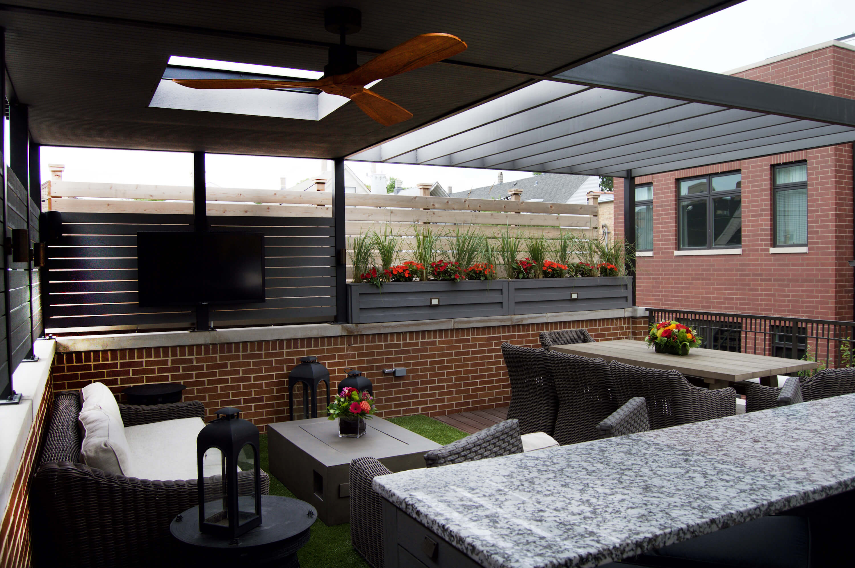 Rooftop deck with pergola and outdoor kitchen