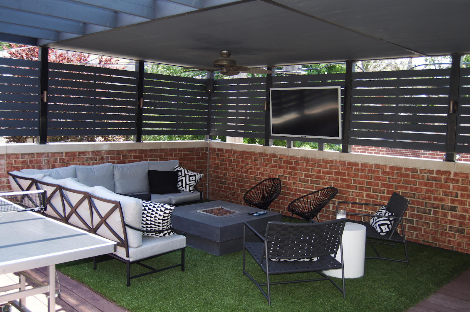 Outdoor lounge with fire pit and TV chicago