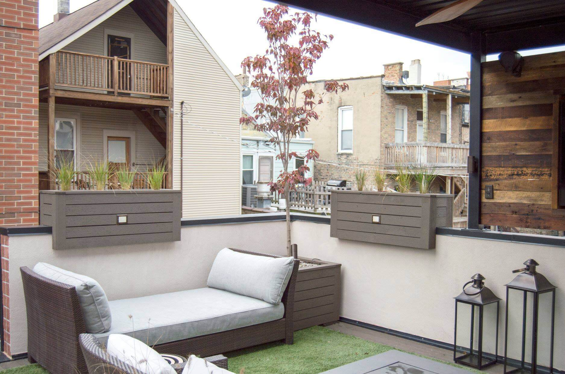 Rooftop lounge with planters