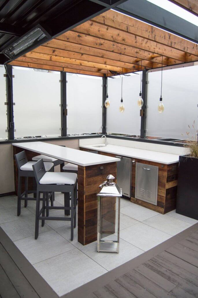 Pergola with outdoor kitchen and bar