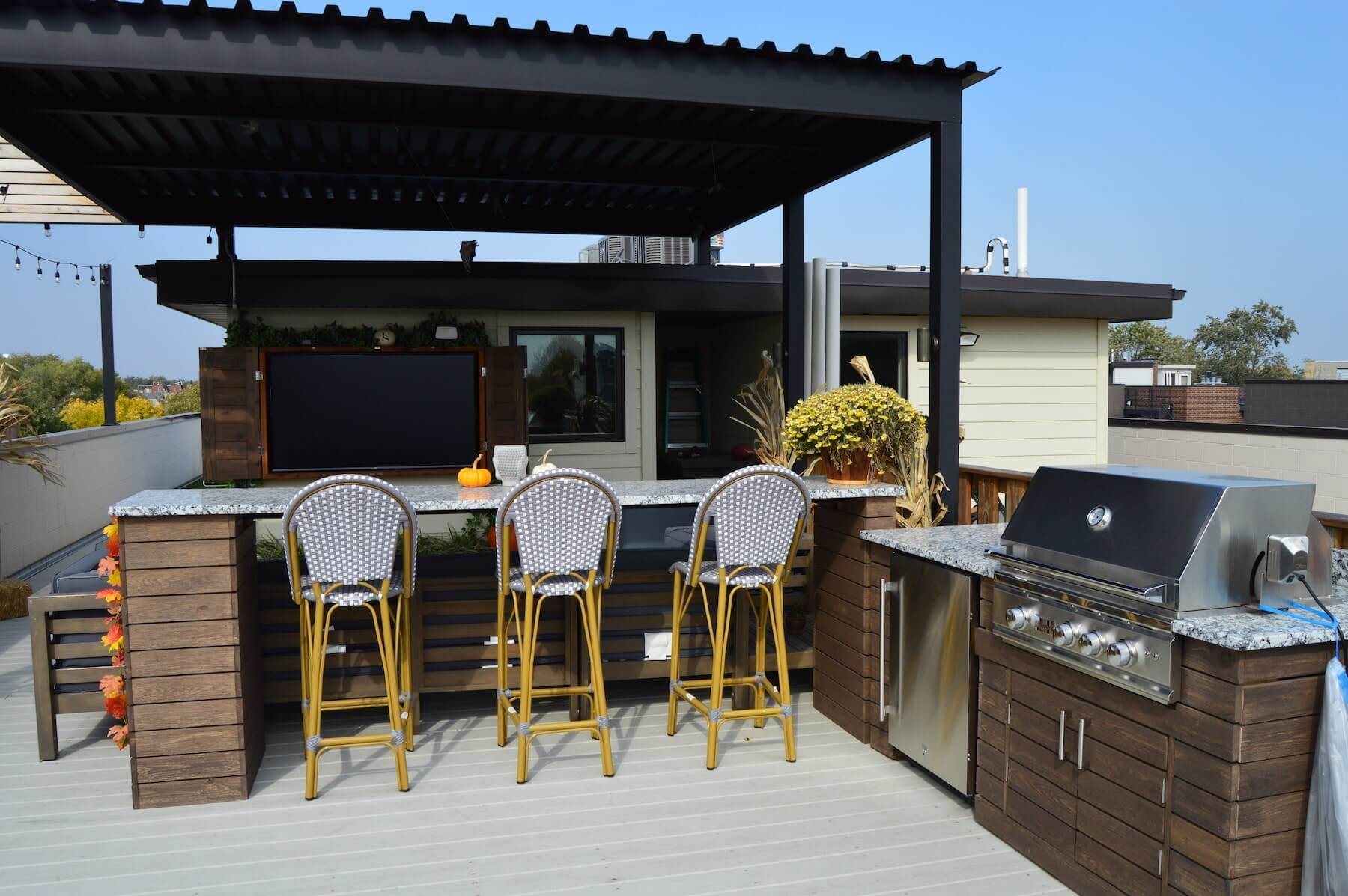 rooftop deck with outdoor kitchen bar and grill steel pergola chicago il